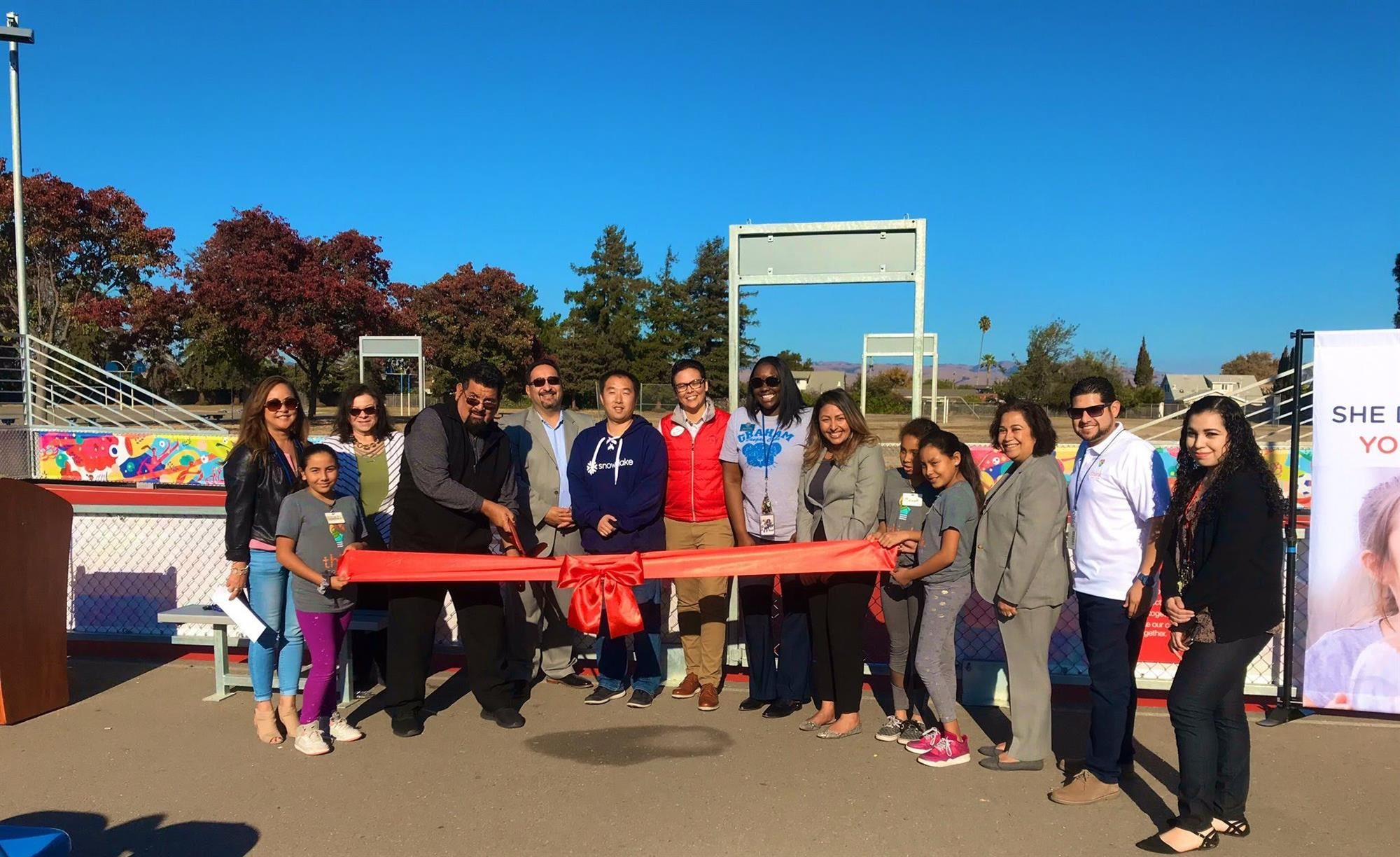 Newark's Graham Elementary cutting the ribbon on a mini-pitch