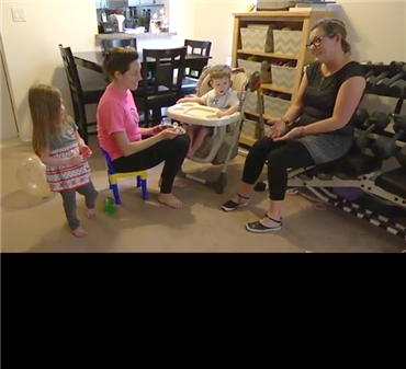 Photo of an early intervention specialist speaking with a family.