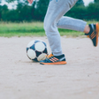 image of youth playing soccer